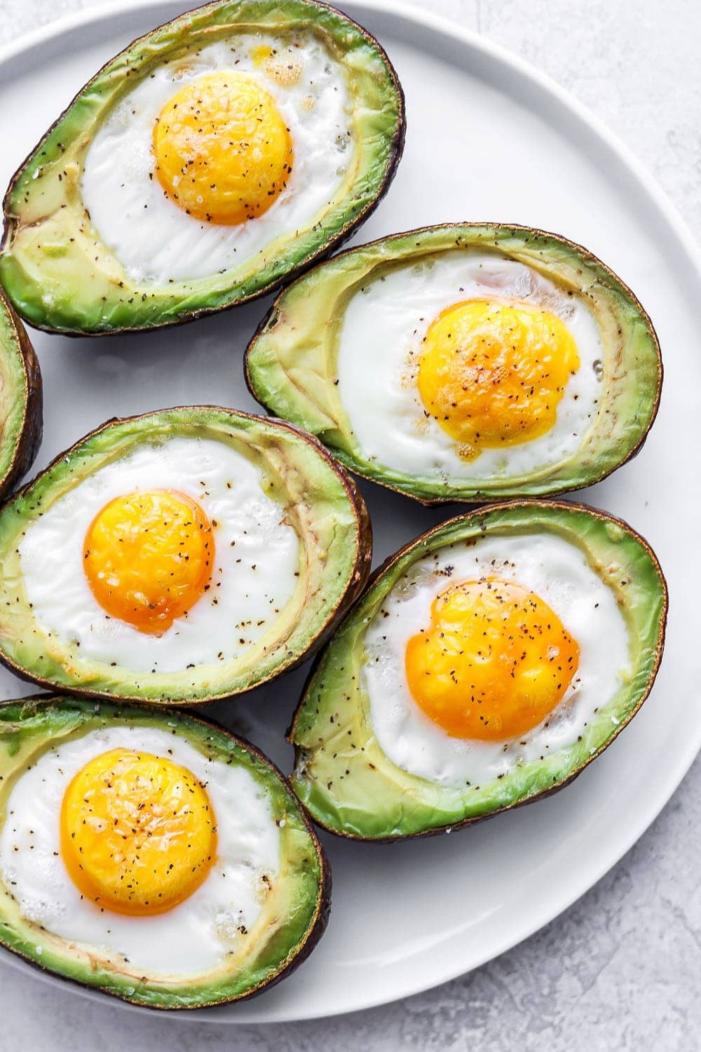 Avocado baked eggs on a plate