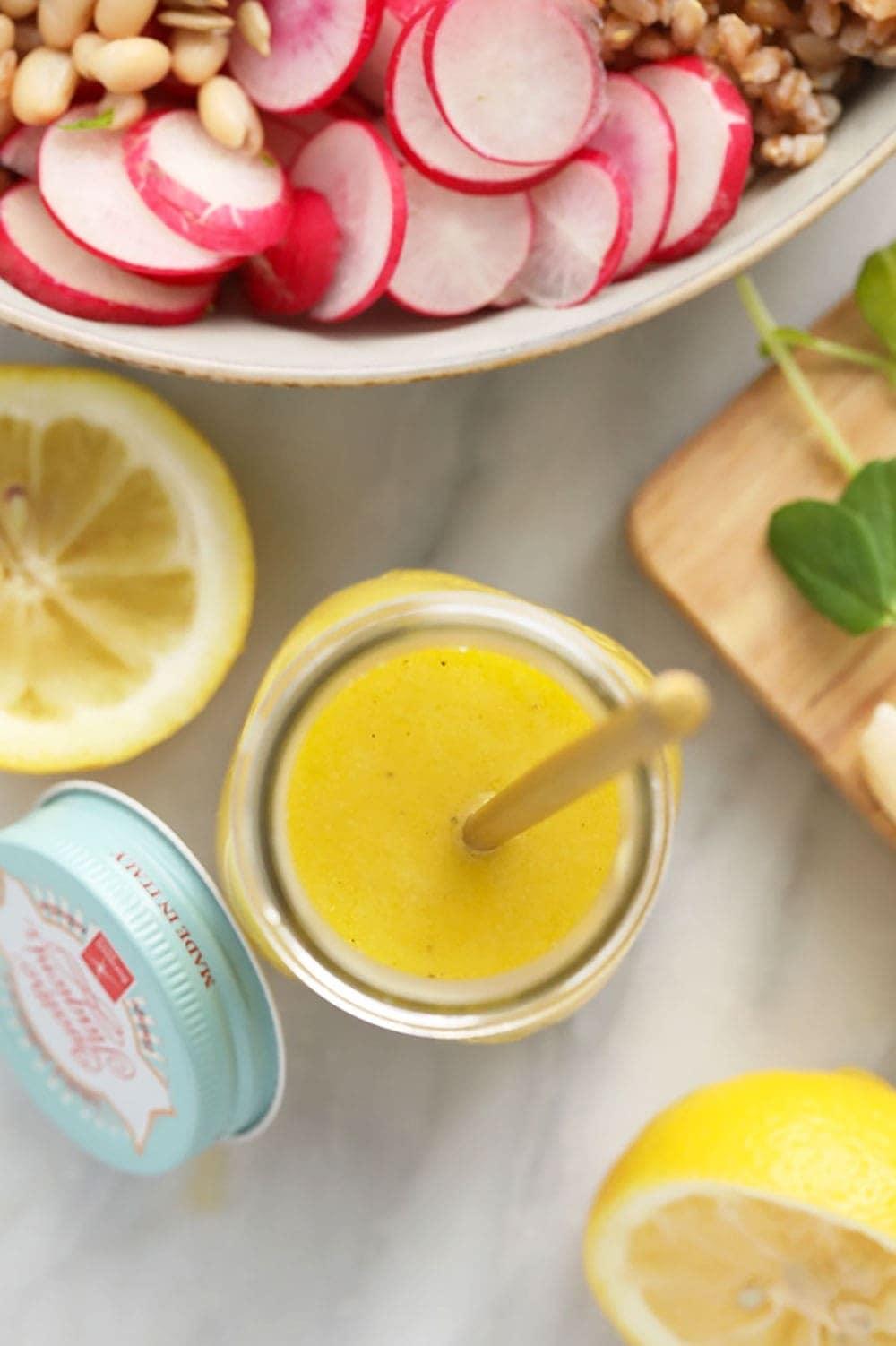 homemade lemon vinaigrette dressing in a jar ready to dress a salad