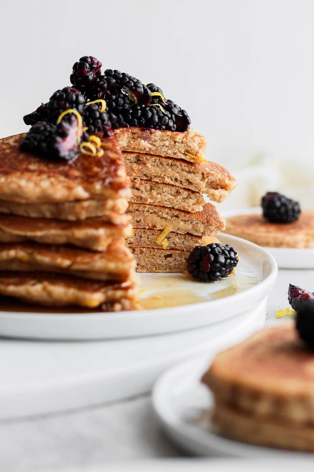 healthy lemon ricotta pancakes stacked and topped with blueberries