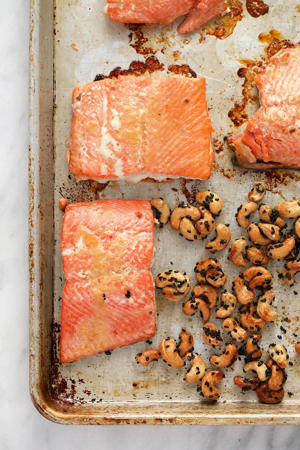 salmon and cashews on pan