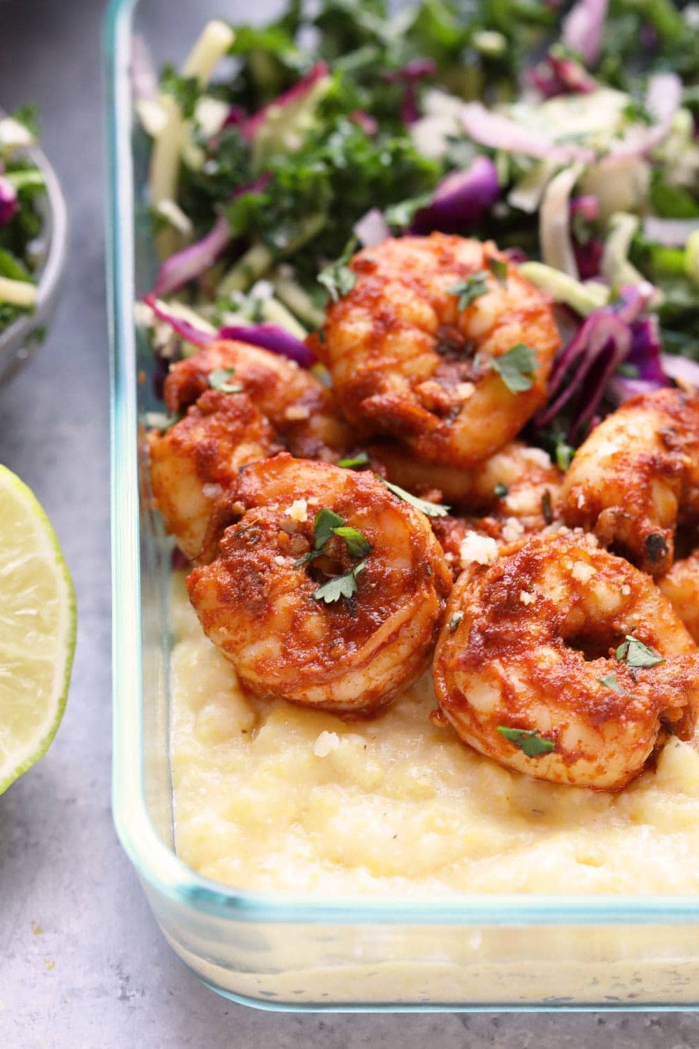 Cajun Shrimp and Grits in a meal prep container