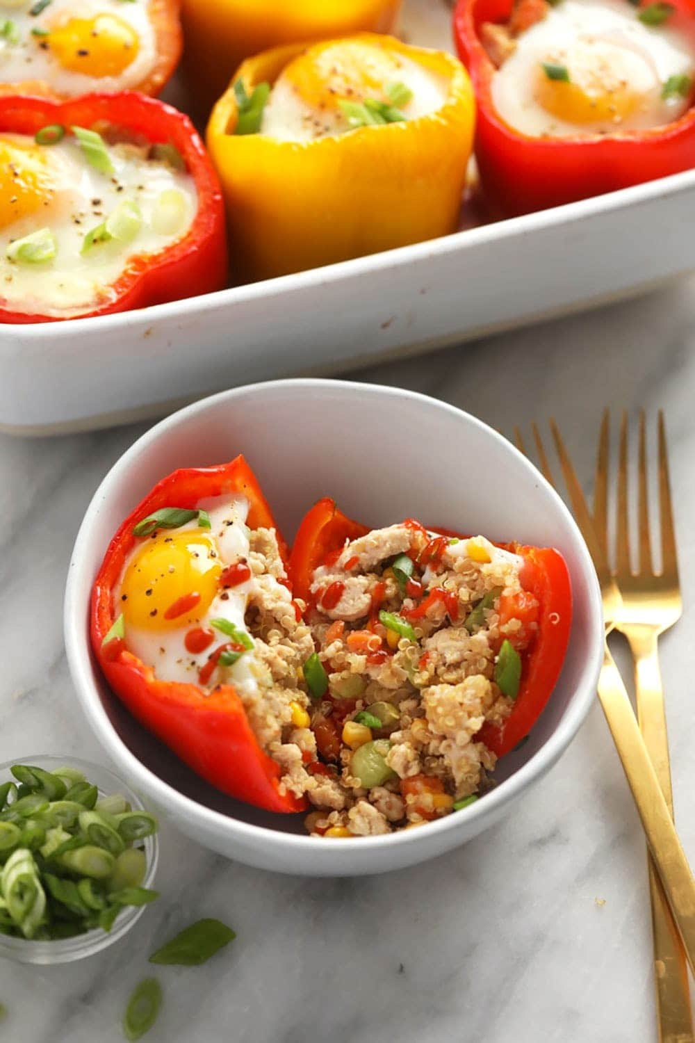 chicken fried quinoa stuffed pepper cut in half