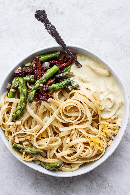 creamy vegan asparagus pasta in a bowl