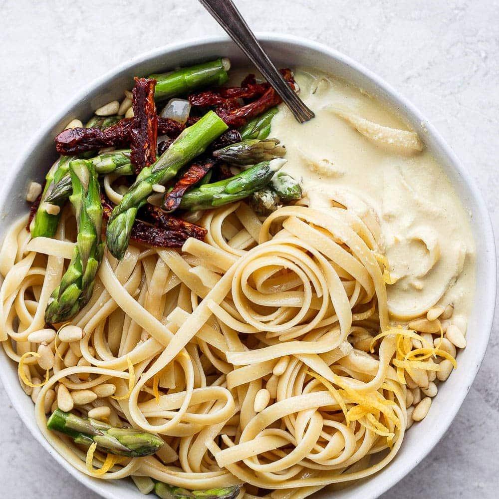 creamy vegan asparagus pasta on a plate