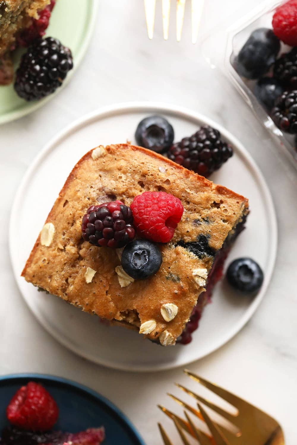 Triple berry breakfast bread on a plate