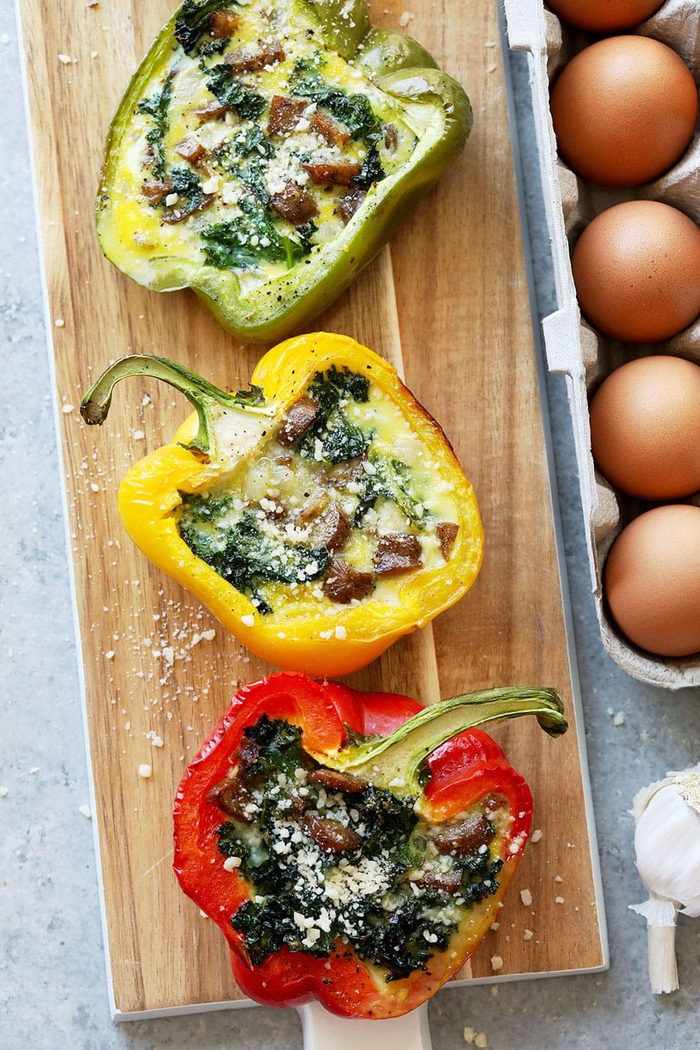 Cheesy Breakfast Sausage Stuffed peppers on a cutting board