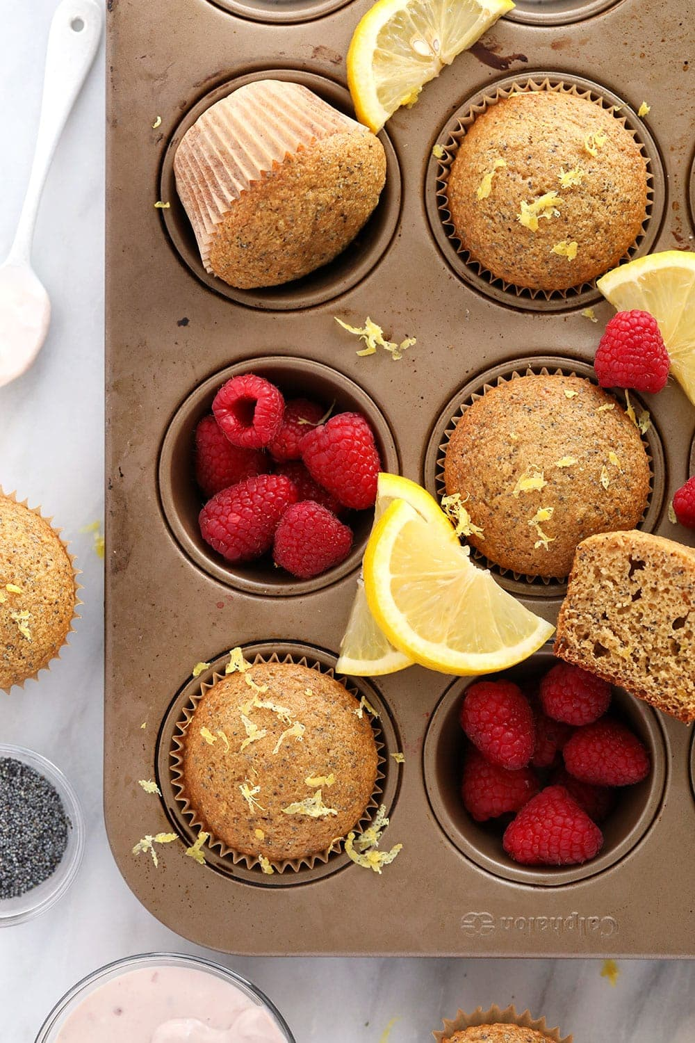 healthy lemon poppy seed muffins in a muffin tin