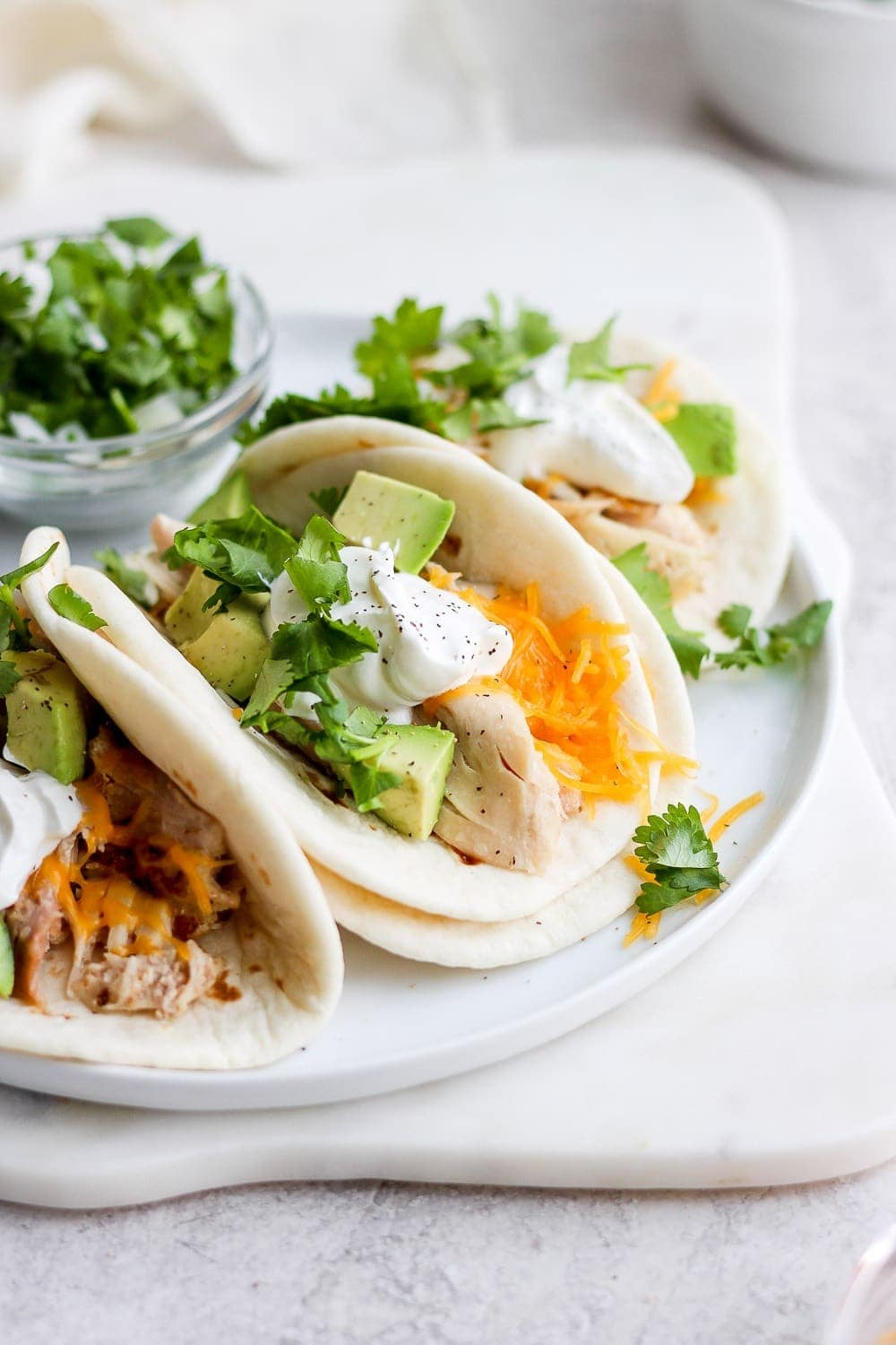 shredded chicken tacos on a plate