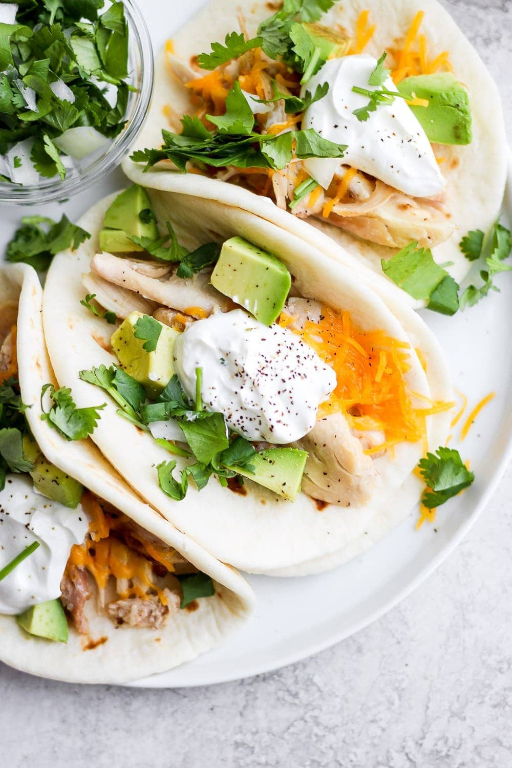 shredded chicken tacos on a plate and ready to be served