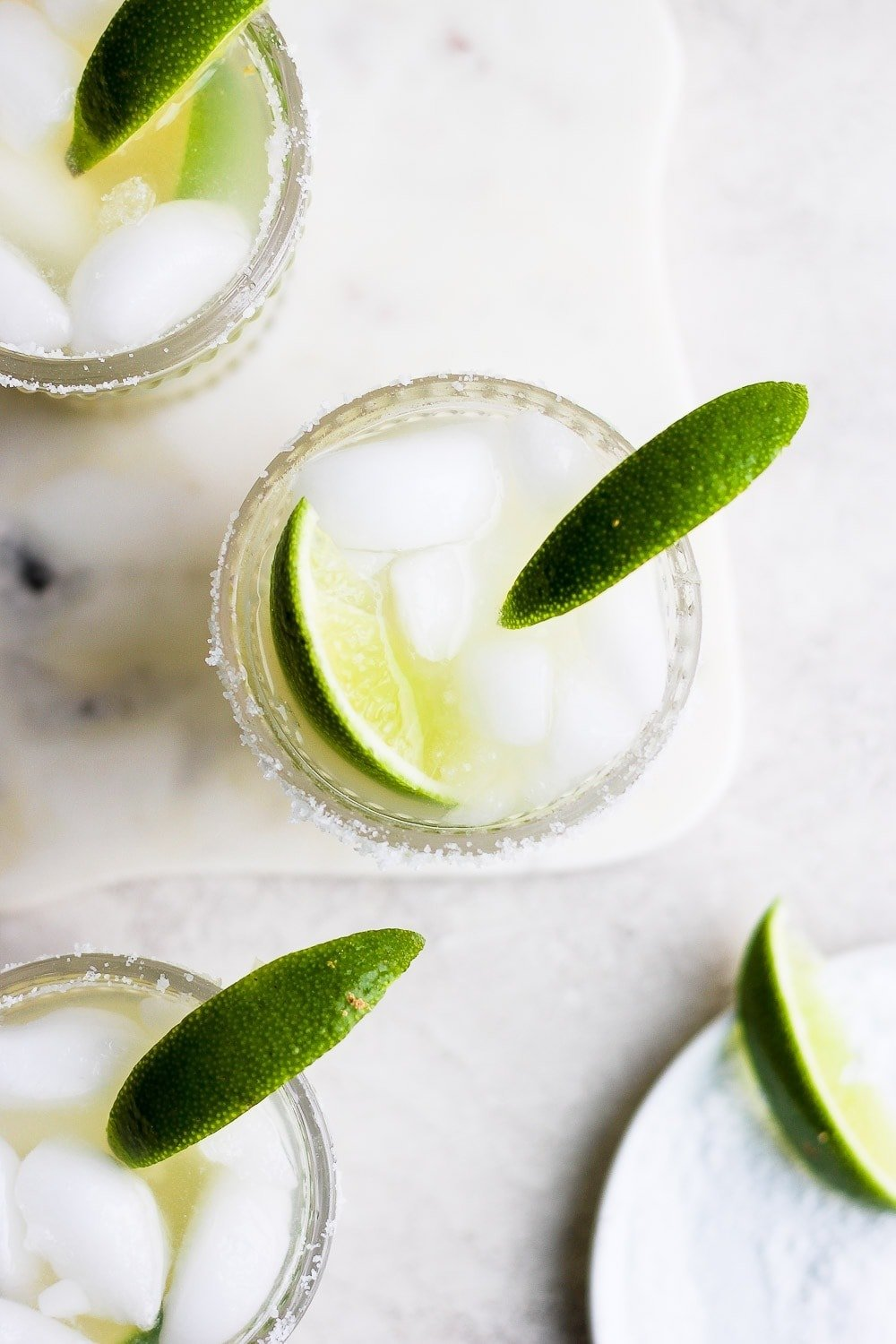 margaritas in glass with lime
