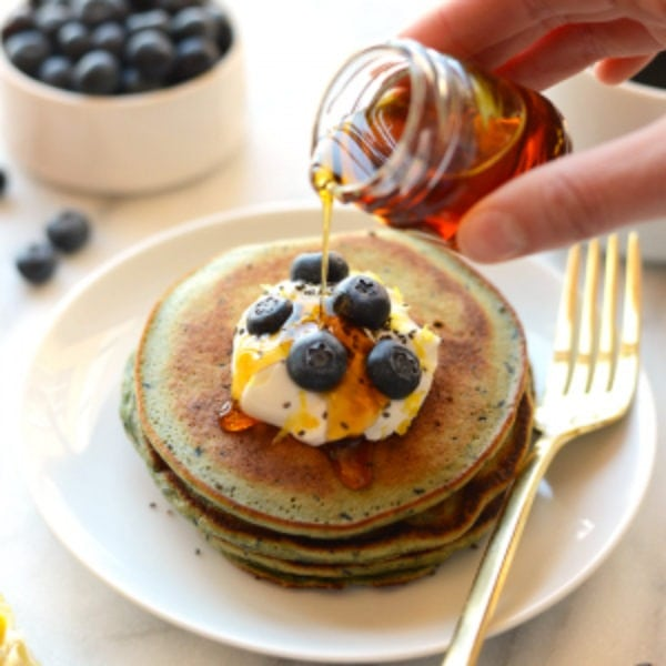 blender lemon blueberry pancakes on a plate