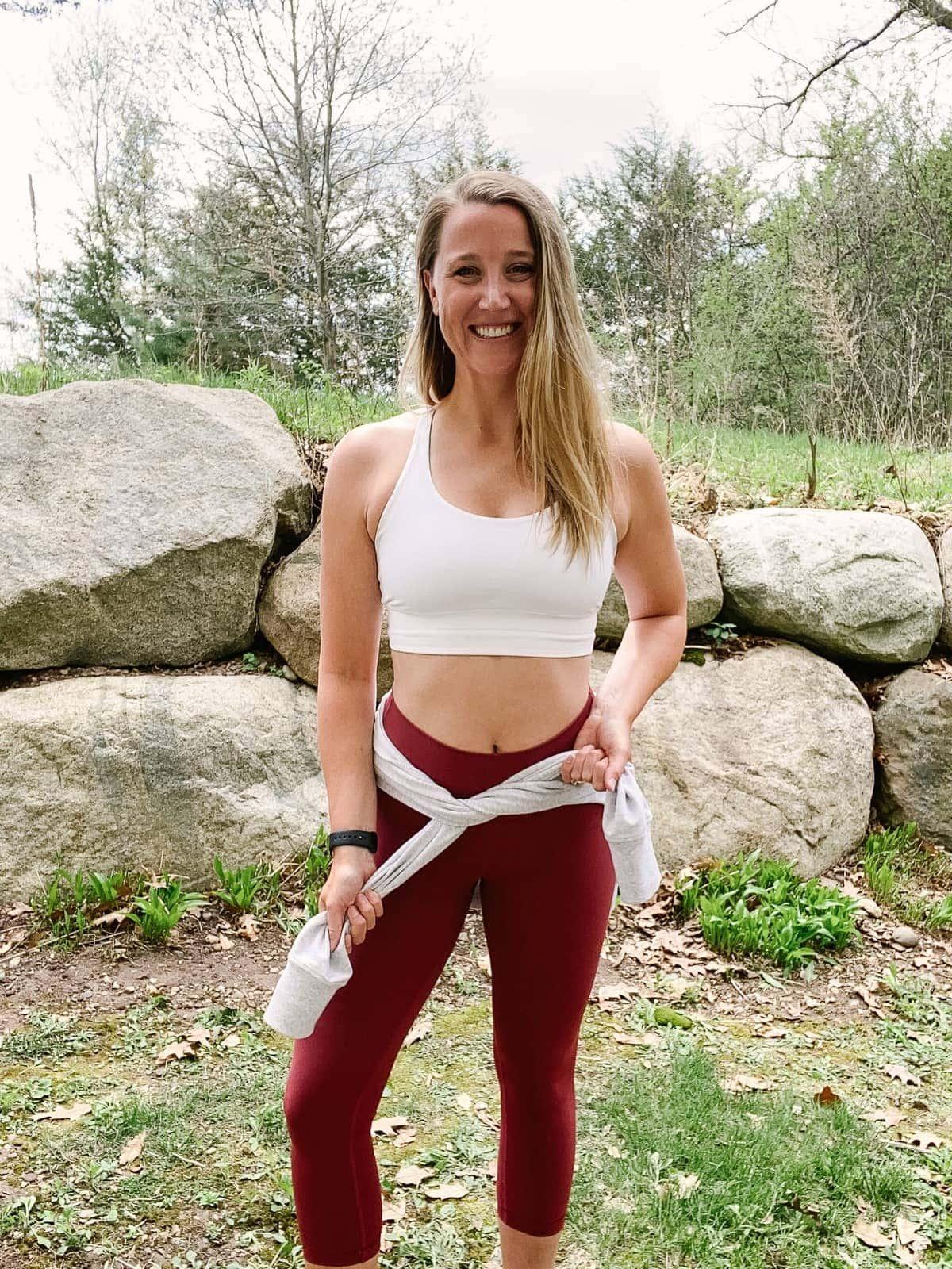 Emily wearing a white long line energy bra