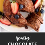 healthy chocolate pancakes topped with fresh fruit slices