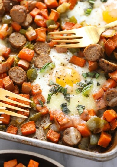 sweet potato hash with eggs on sheet pan with forks