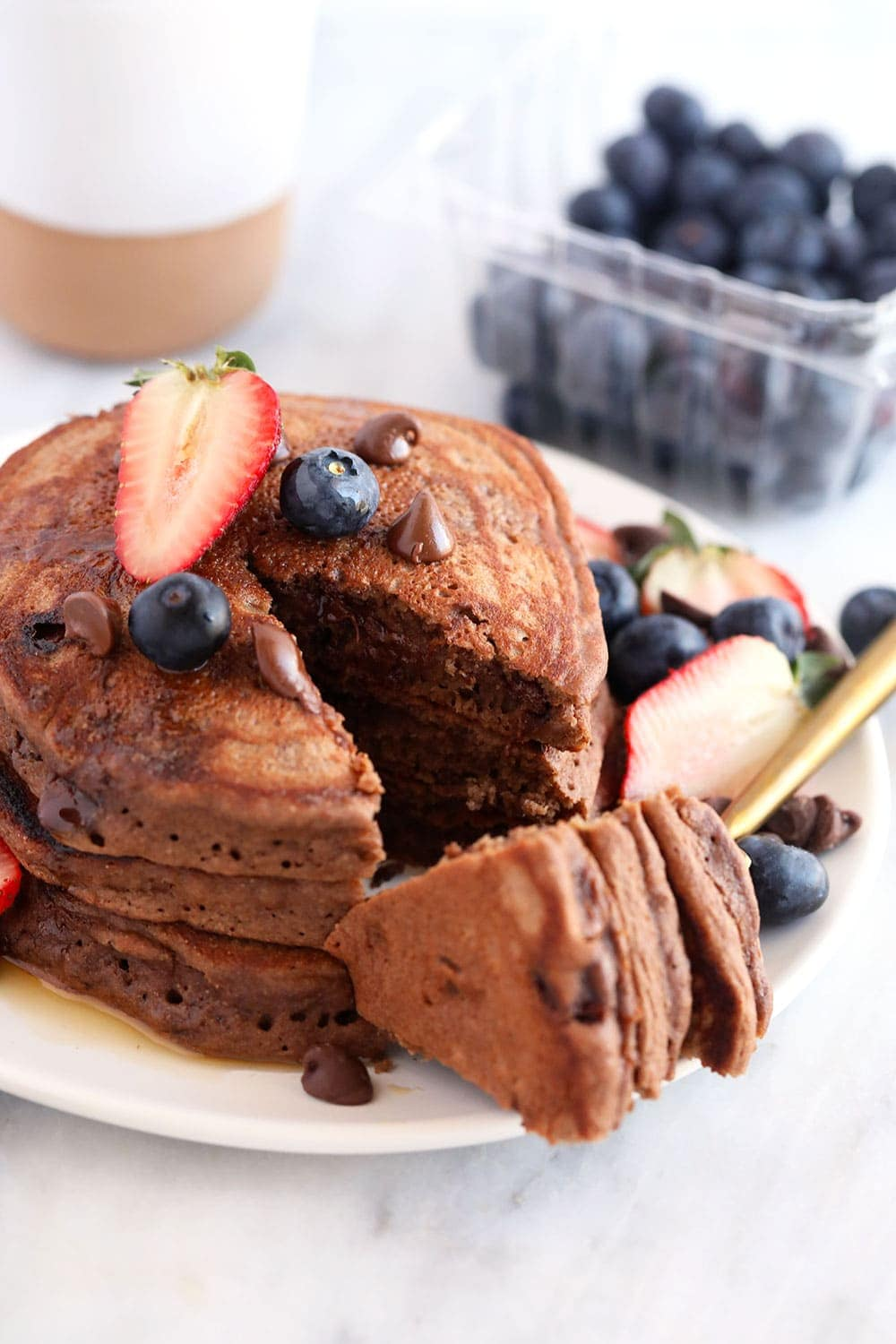 3 chocolate chocolate chip pancakes on a plate
