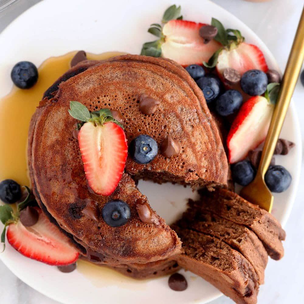 chocolate chocolate chip pancakes on a plate