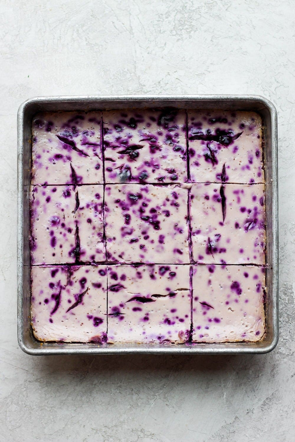 blueberry cheesecake bars after baking in a square baking dish