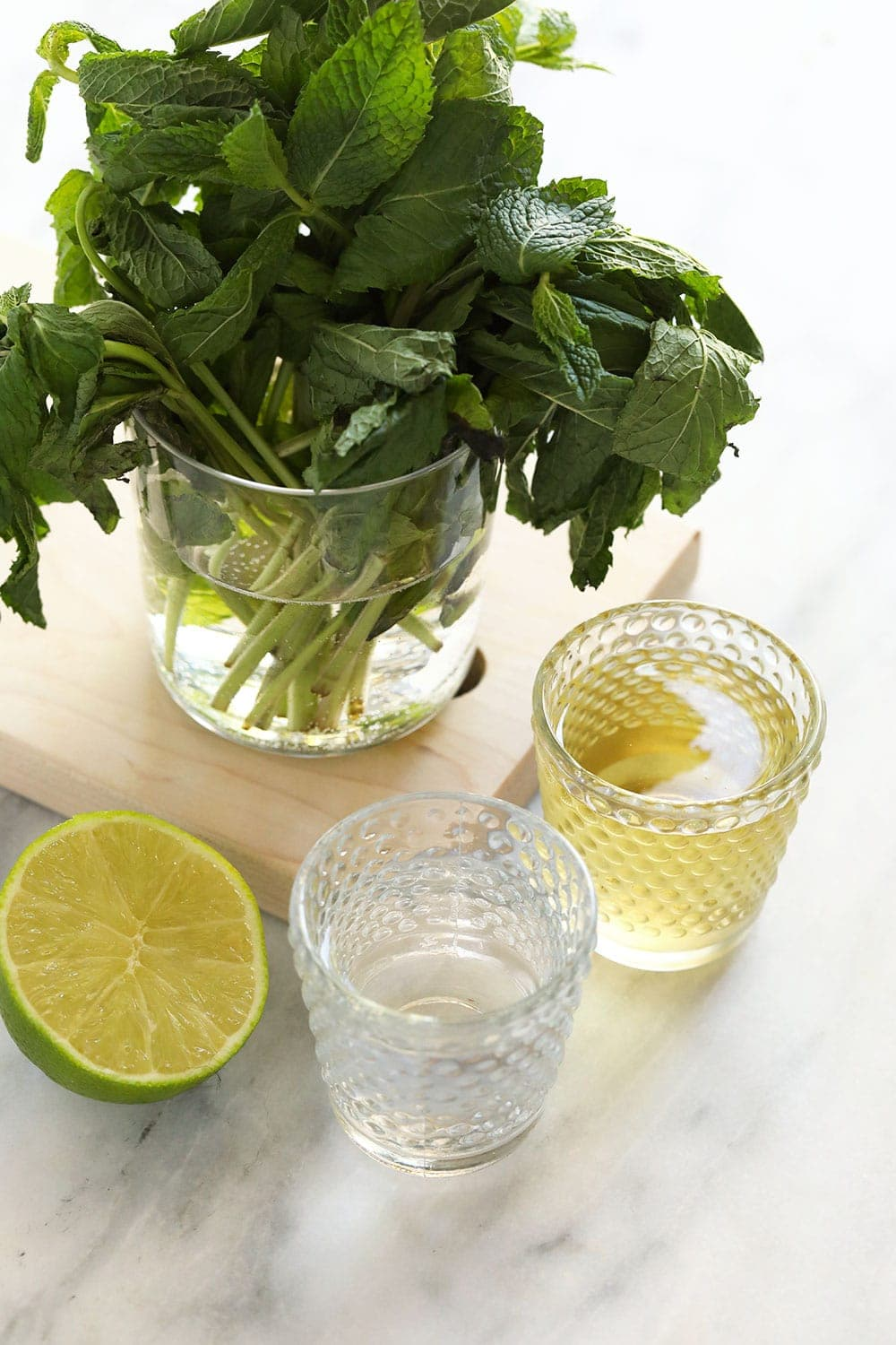fresh mint, simple syrup, rum, and lime