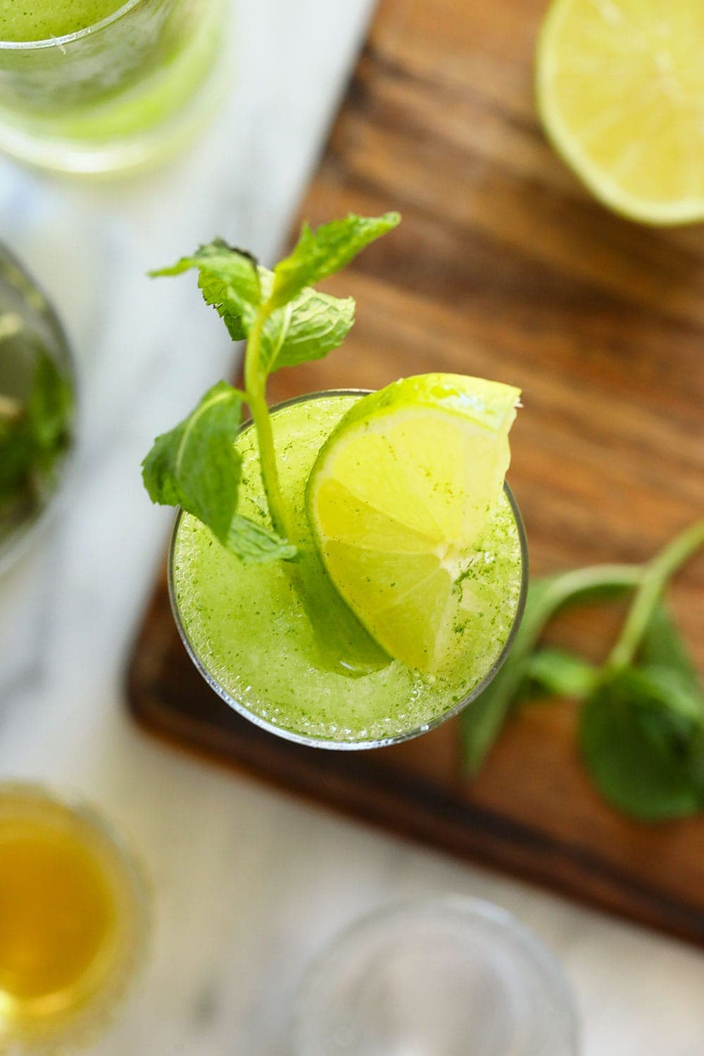 top down photo of frozen mojito with fresh mint and lime