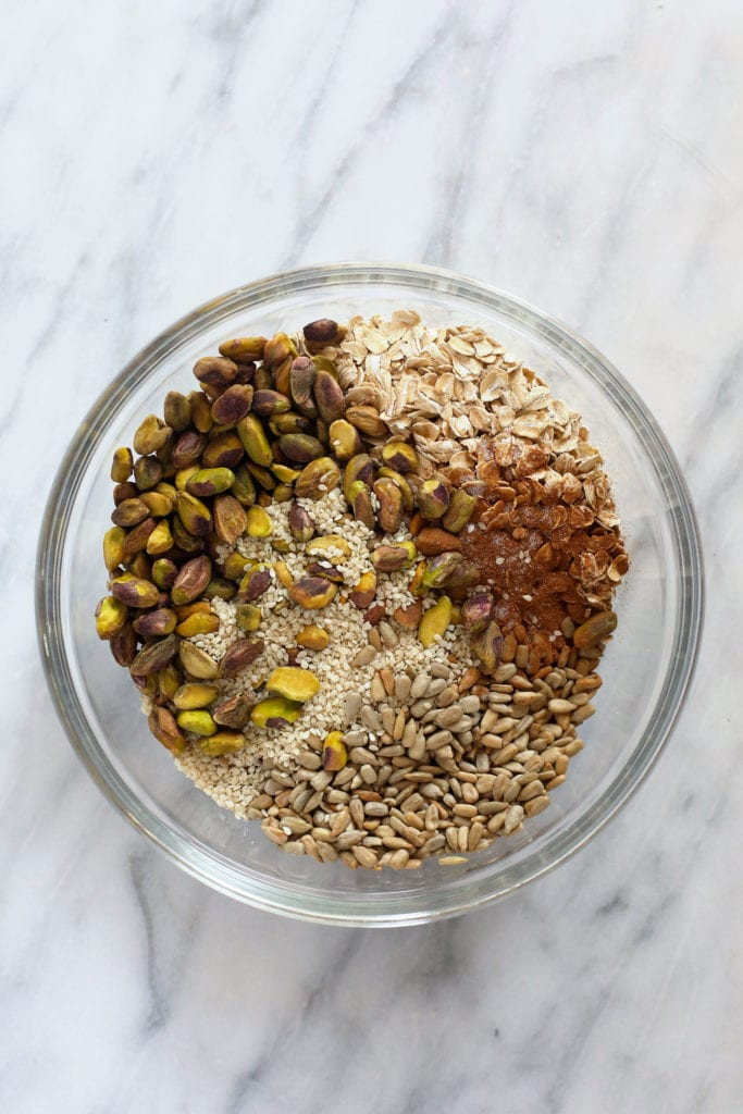 All of the ingredients for pistachio cherry granola in a bowl.