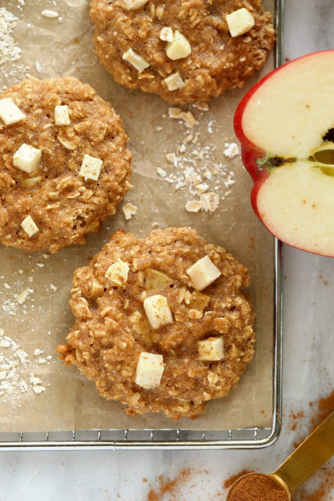 Baked apple oatmeal cookies on a cooling rack.