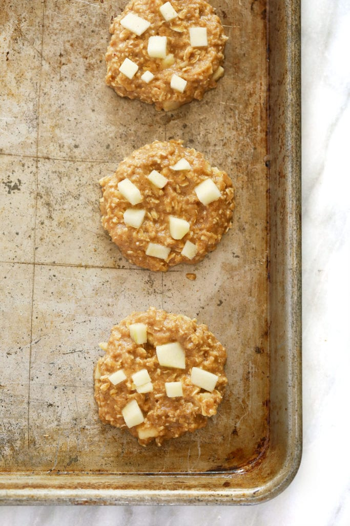 Apple oatmeal cookies on a baking sheet before they are baked.