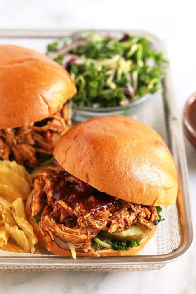 pulled chicken on bun with chips