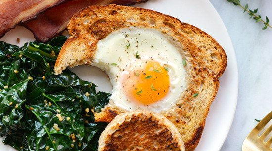 egg in a frame with a bite taken out of the bread
