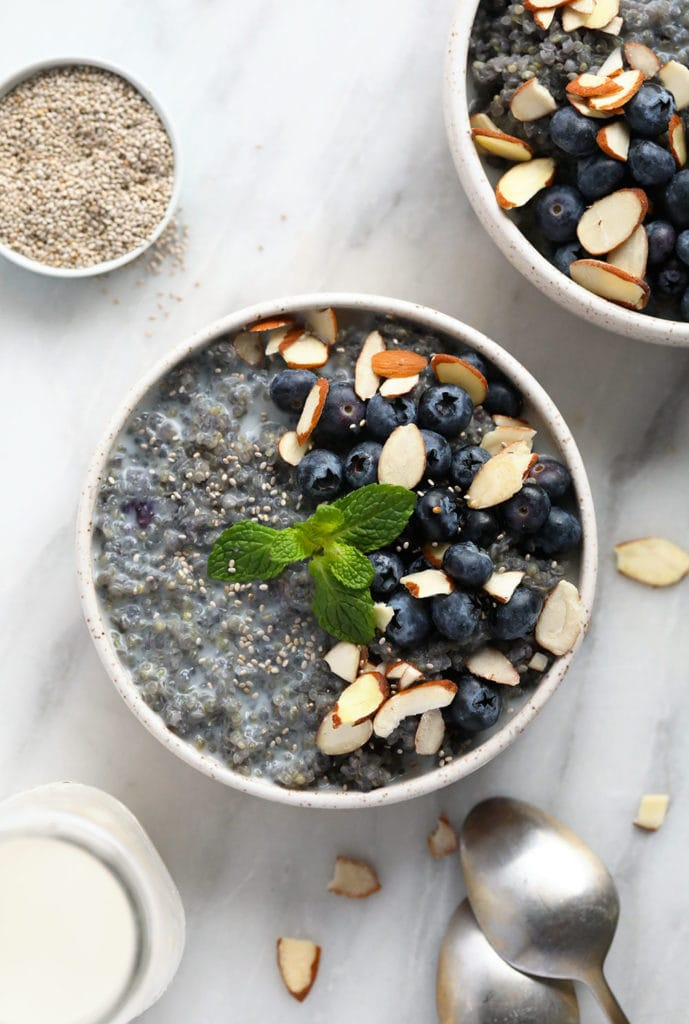 Blueberry quinoa breakfast bowl in a bowl and ready to eat.