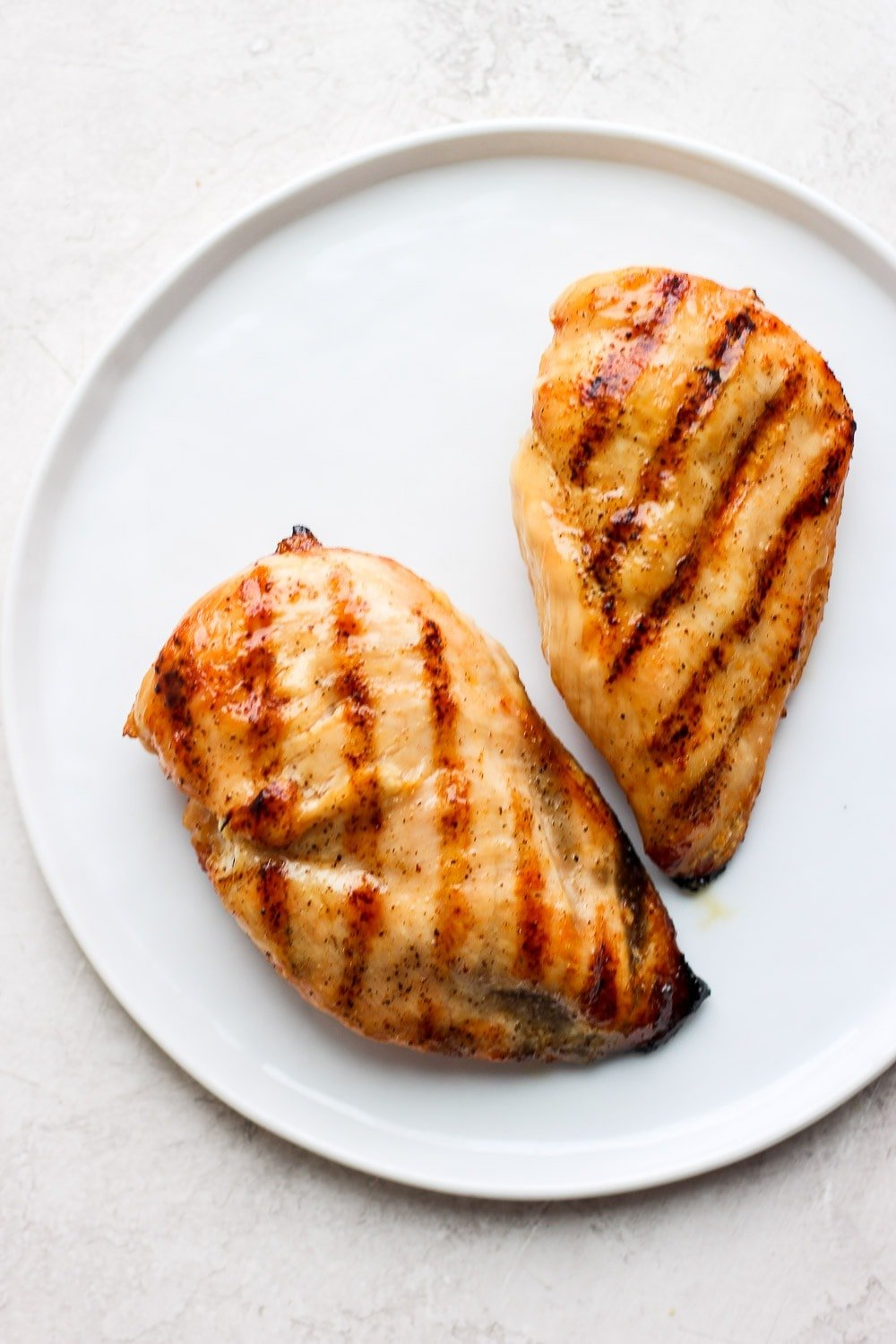 2 grilled chicken breasts on plate