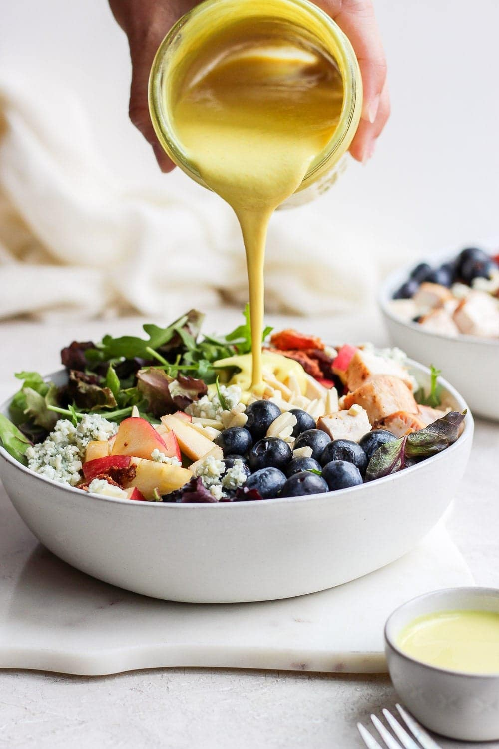 Pour the honey mustard sauce over the chicken salad in the bowl
