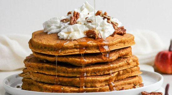 dairy free pancakes topped with maple syrup