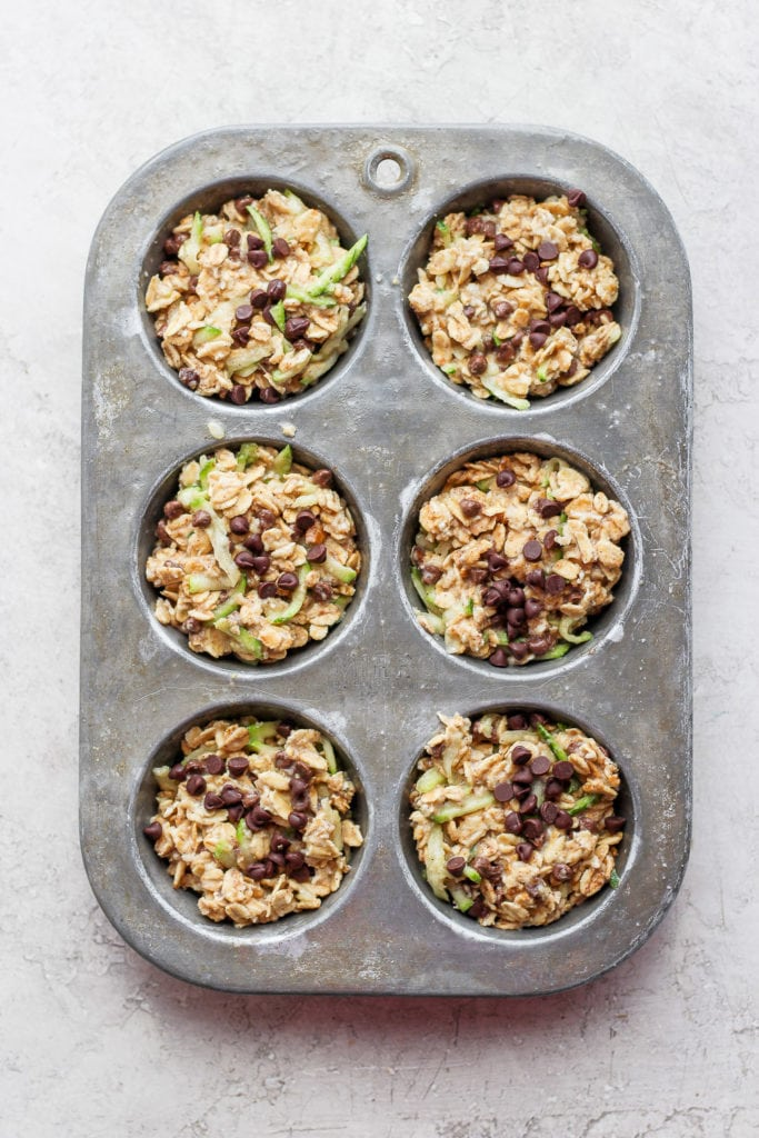 Zucchini oatmeal cups in a muffin tin.