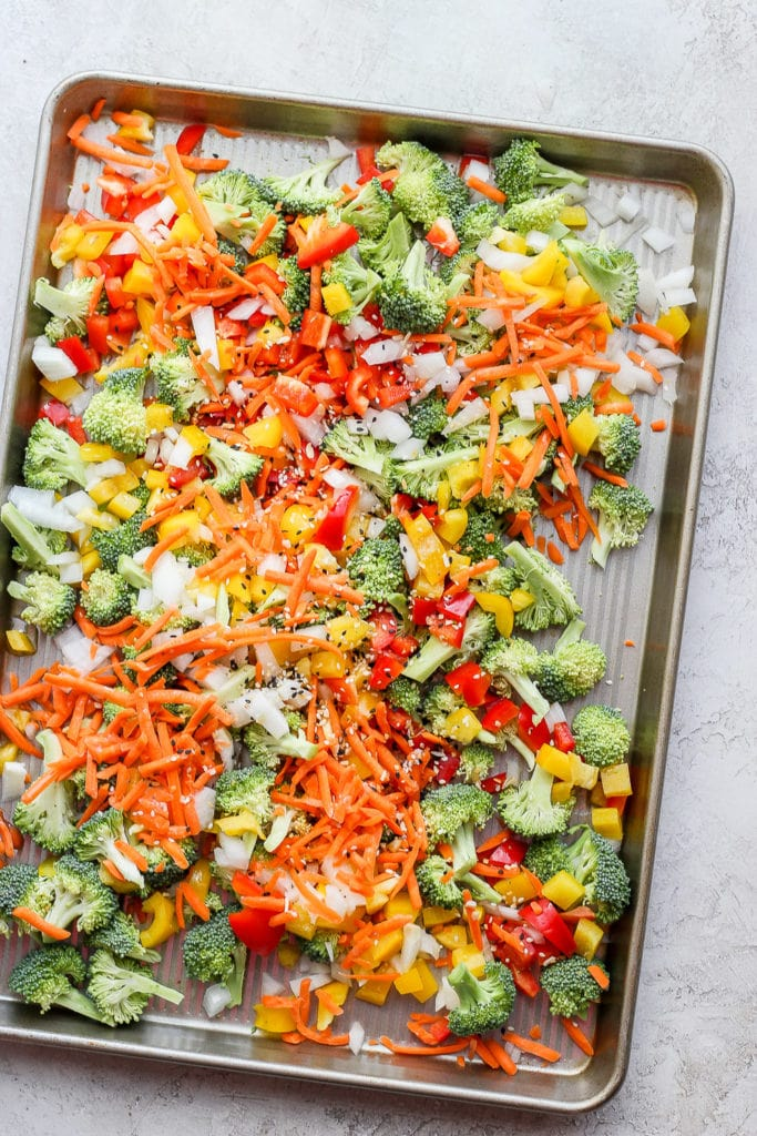 veggies for sheet pan salmon stir fry ready to be roasted in the oven