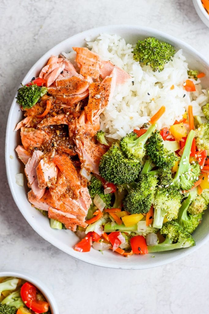 sheet pan salmon stir fry in a bowl with rice