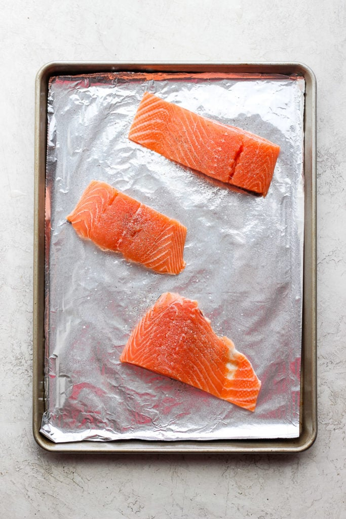 salmon filets on a sheet pan ready to be broiled