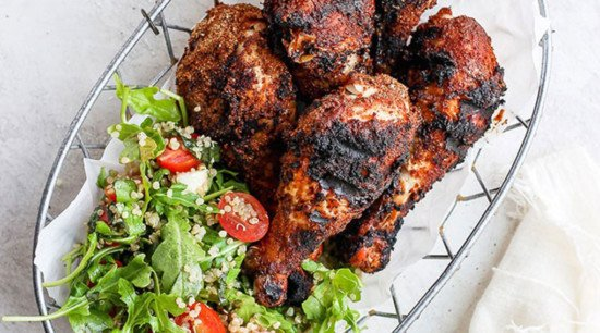grilled chicken legs with a kale salad