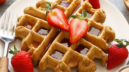 waffles topped with fresh strawberries