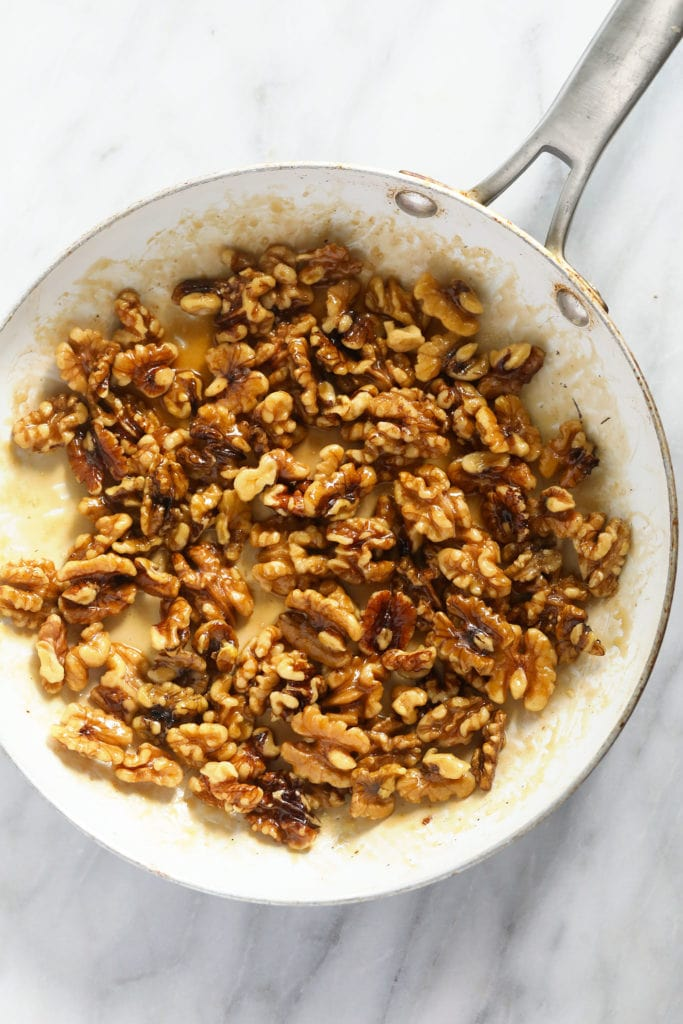 Candied walnuts in a pan