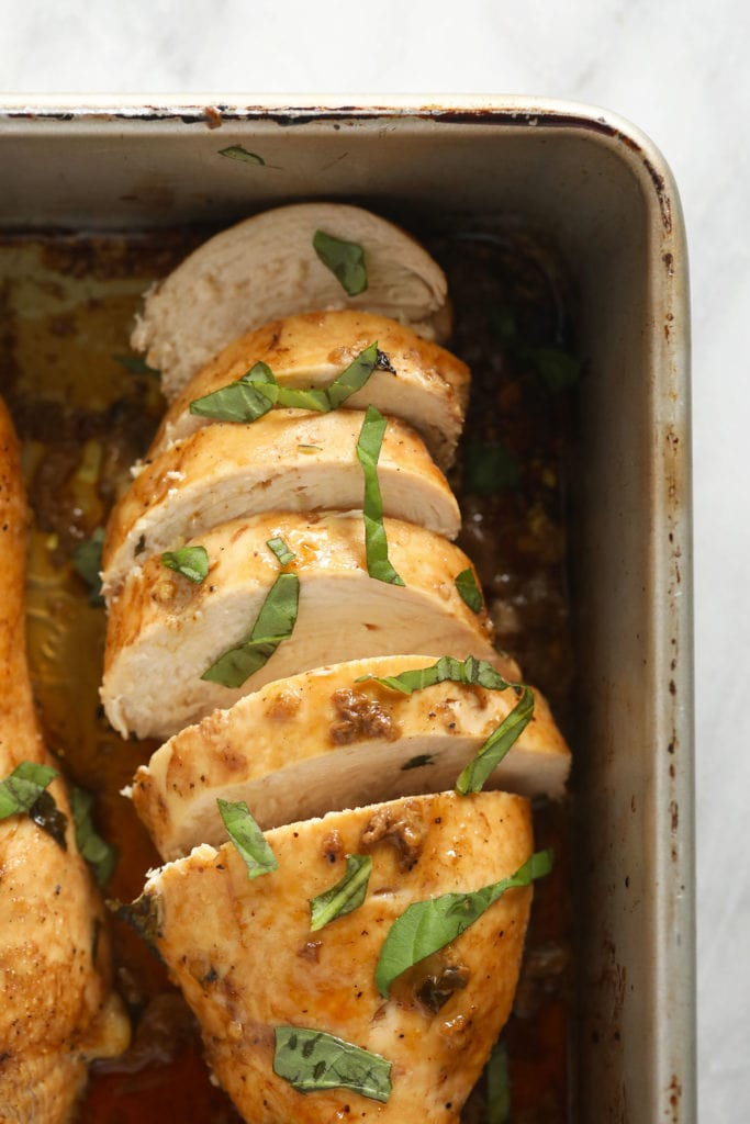 Marinated balsamic chicken in a pan.