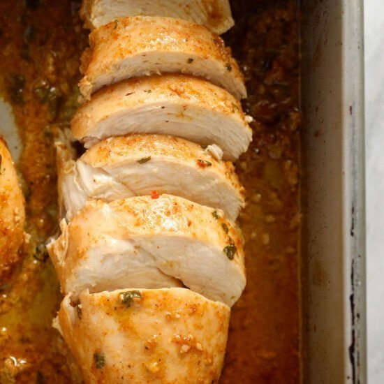 chicken marinating in a pan.