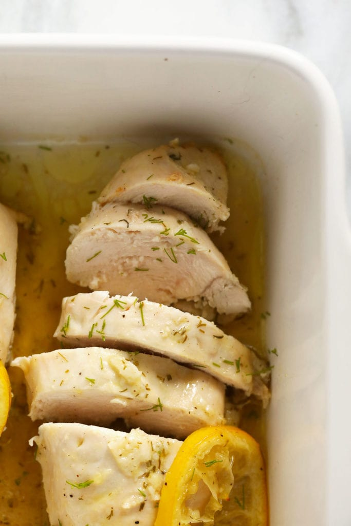 sliced lemon chicken in a baking dish