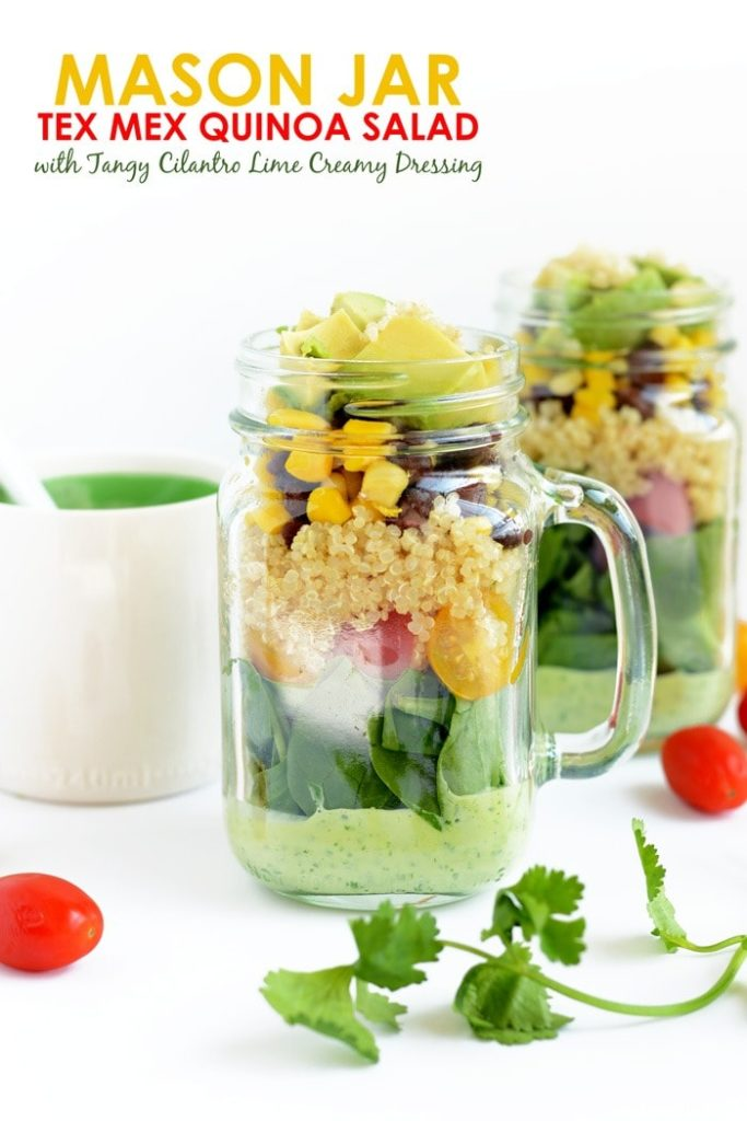 A mason jar salad with dressing on the bottom and ingredients on the top.