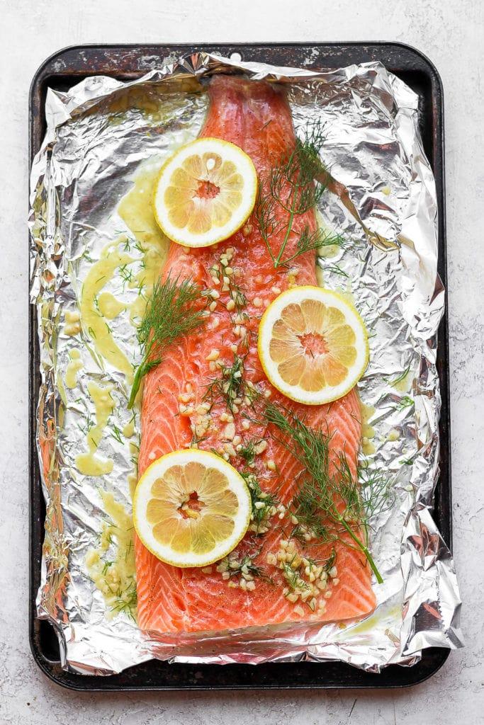 A full salmon fillet marinating