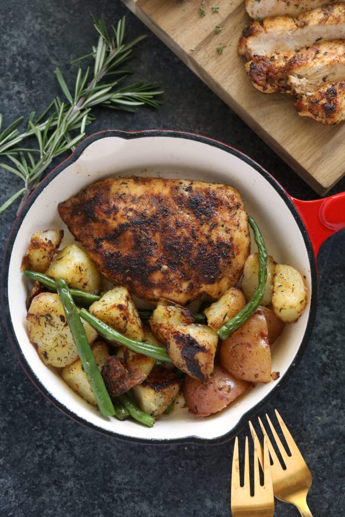 chicken breast in pan with potatoes