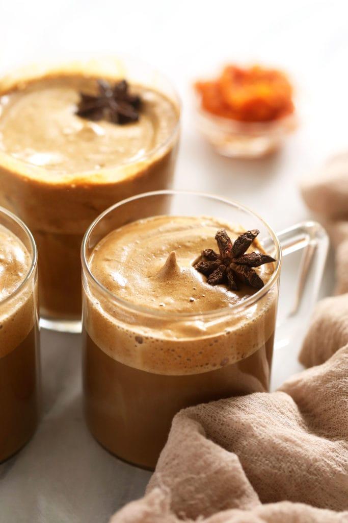 Hot dalgona coffee in mugs.