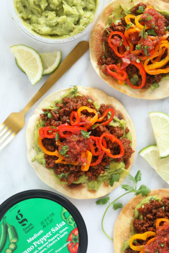 Tostada with lime wedges and mini peppers
