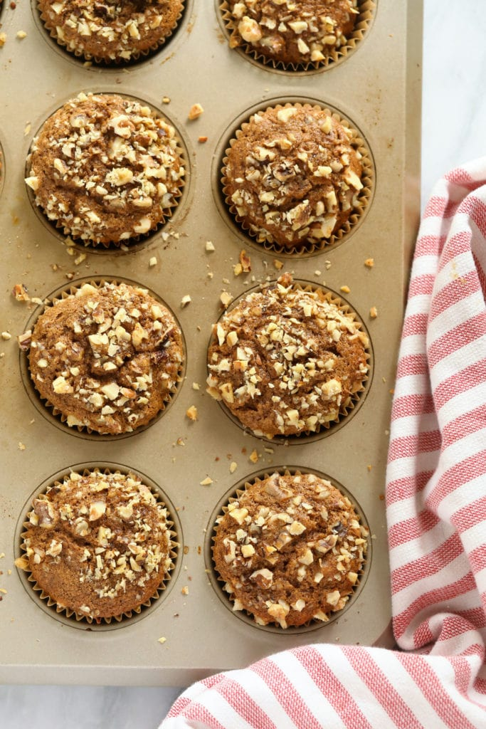 Banana nut muffins in a muffin pan.