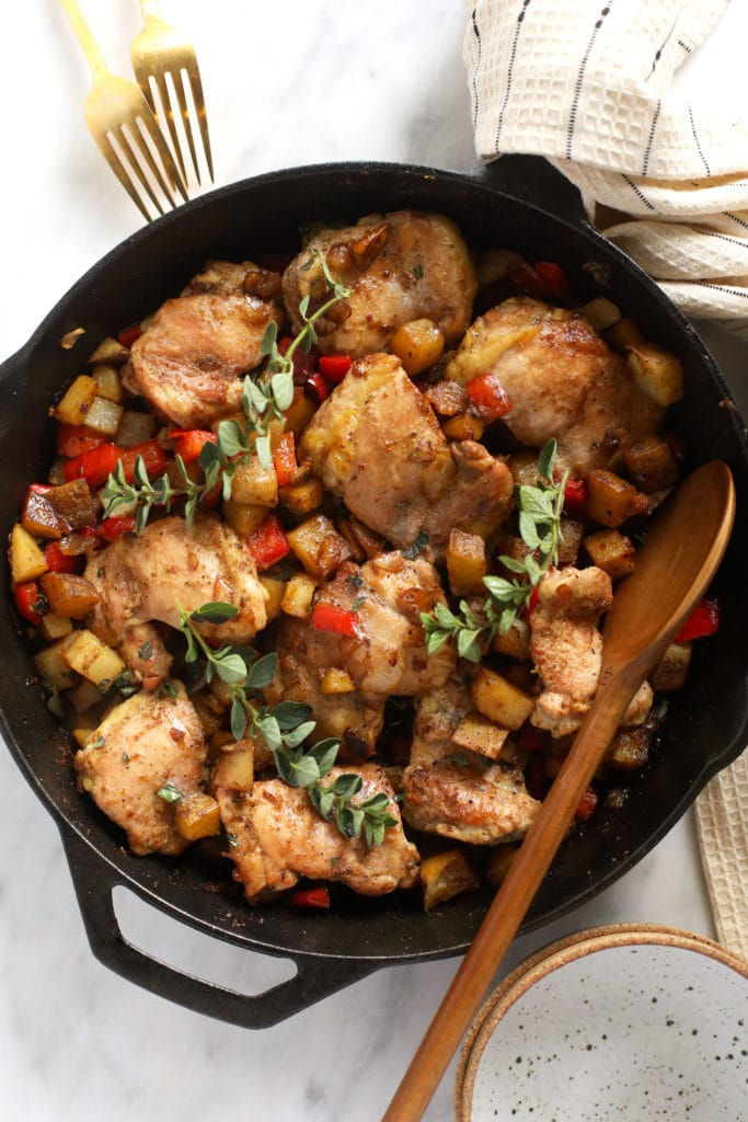 Fry chicken and potatoes in a cast iron pan