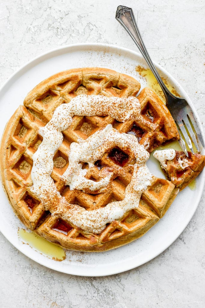 Cinnamon roll waffles with Greek yogurt and cream cheese drizzle